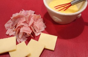 4. Chop 2 slices of ham & slice a French cheese into 4 squares. I used Beaufort-similar to Gruyere