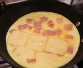 8. Cook on medium low heat with lid on until egg is set and cheese melted