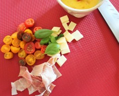 4. Chop baby tomatoes, Mozzarella cheese, basil, proscuitto enough to feed one person to taste